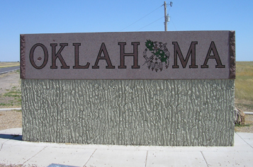 https://assets.sourcemedia.com/0c/d5/05b17bc543448040eede5603edfb/oklahoma-state-line-sign.jpg