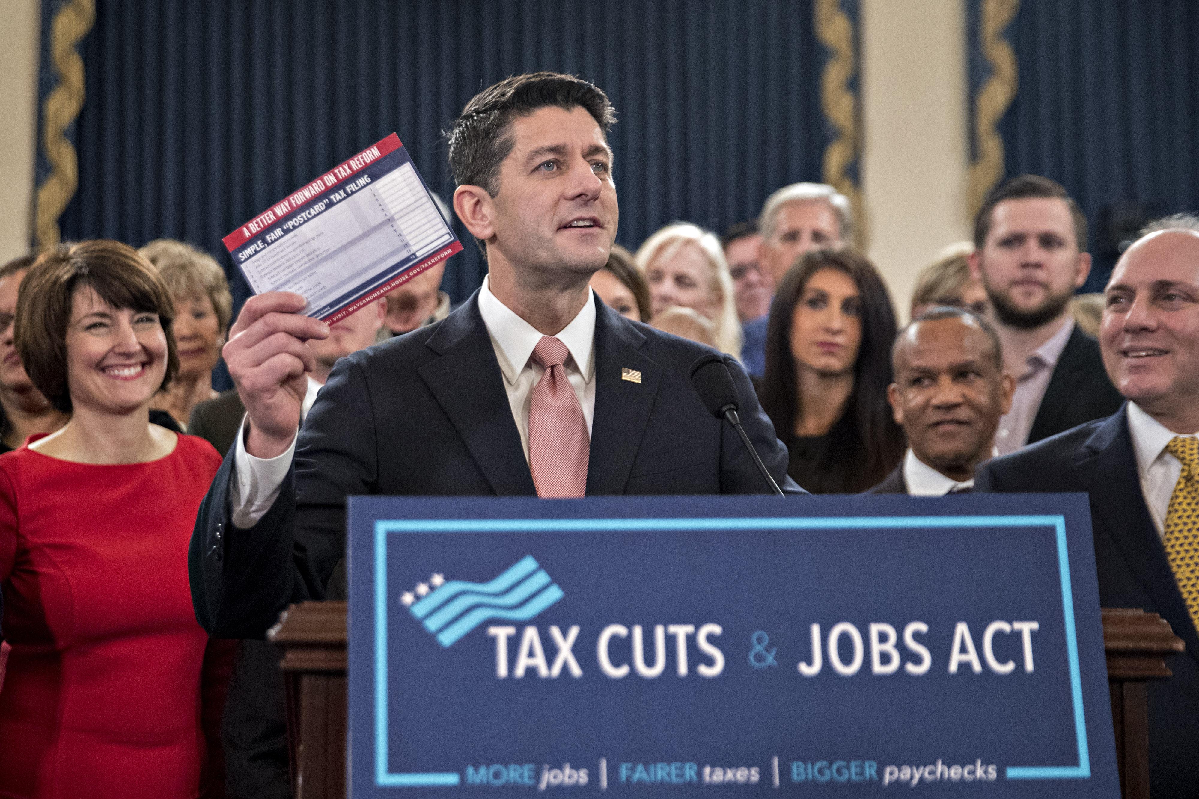 https://assets.sourcemedia.com/4a/15/caf9a2984abd8abdbf41538d8d1d/taxreform.Bloomberg.jpg