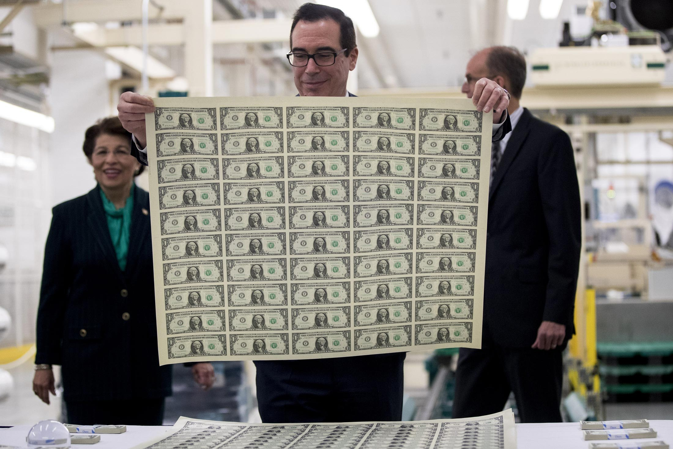 https://assets.sourcemedia.com/52/48/2d1a44734164b3f6925b003d48da/mnuchin-dollar-bills.jpg