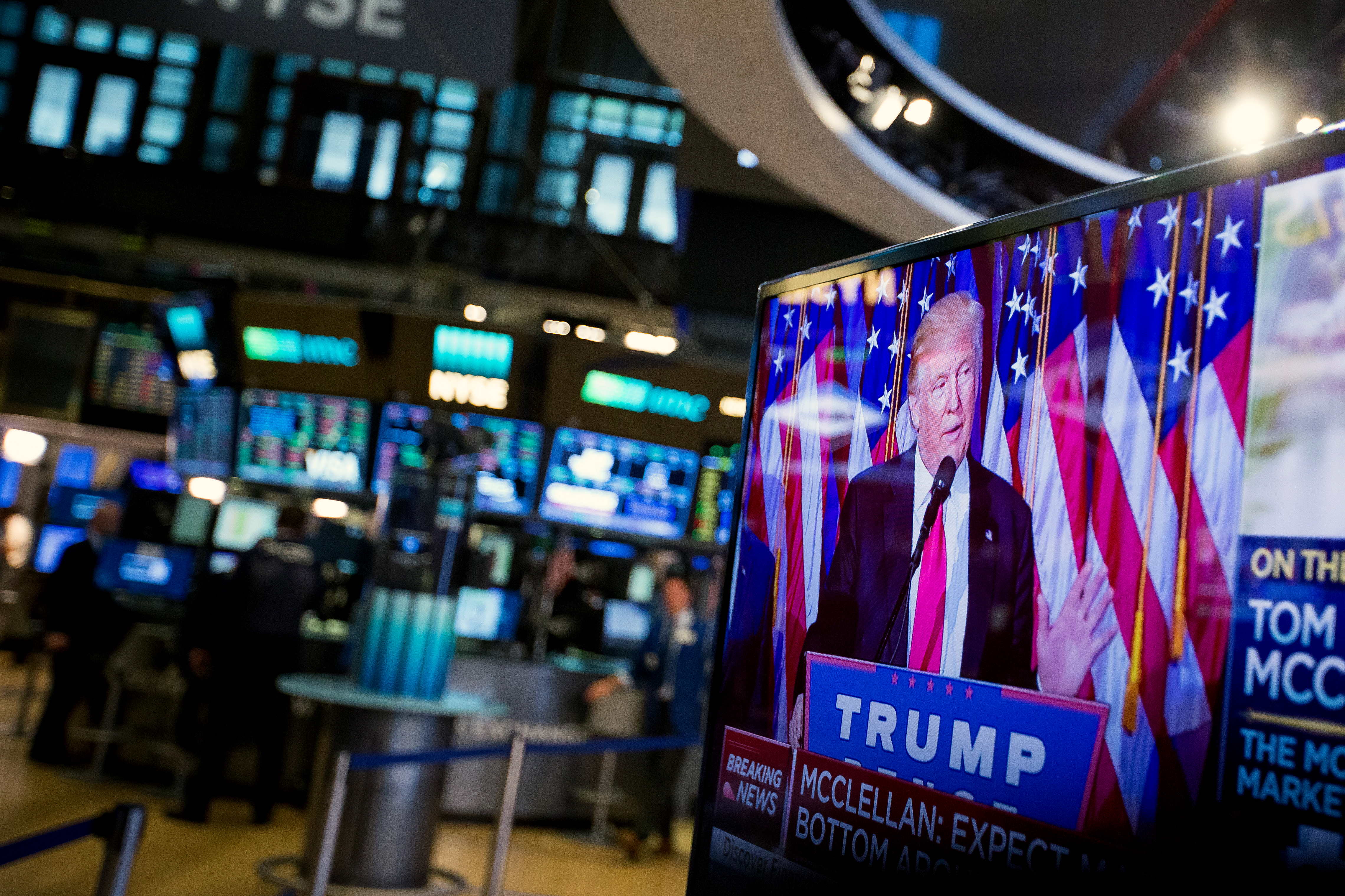 https://assets.sourcemedia.com/88/1f/f8ed9d764d27ac969f4cfc72a2dd/trump-on-tv-at-stock-exchange-bloomberg-news.jpg