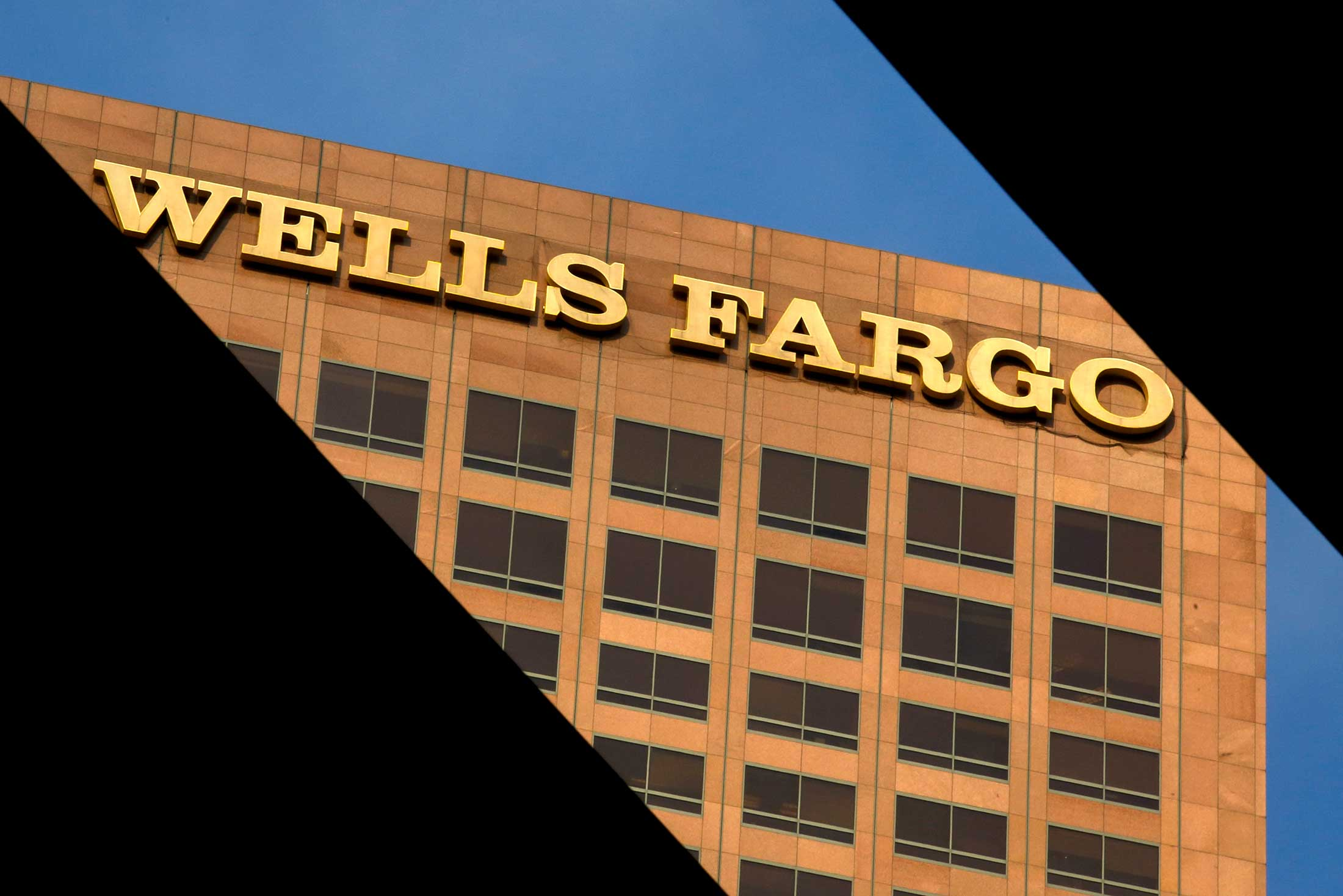 https://assets.sourcemedia.com/96/c7/55b33b224dea8c2b7ca73450ed39/wells-fargo-building-morning-light-bloomberg-news.jpg