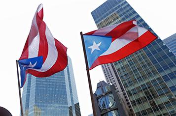 https://assets.sourcemedia.com/cf/e6/482fe30d4009af02d0bf41f93cfd/puerto-rico-flag-bloomberg.jpg